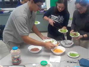 Students use lettuce from Tower Garden as taco shells